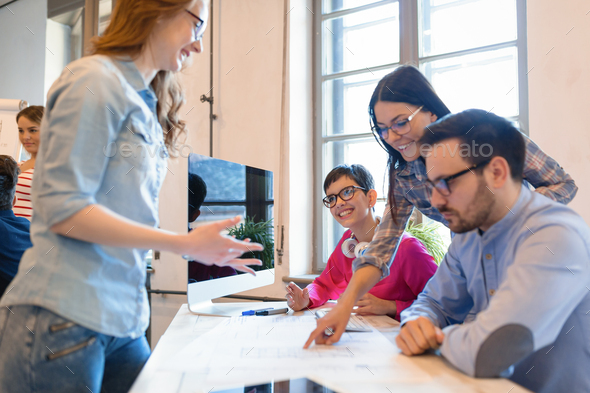 Company coworkers discussing ideas and brainstorming - Stock Photo - Images