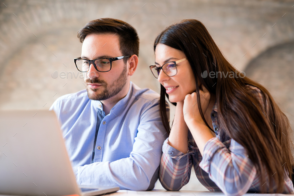 Programmers cooperating at information technology company - Stock Photo - Images