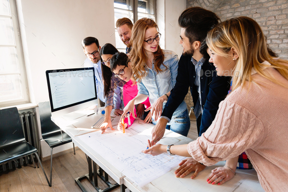 Group of architects working on project in modern office - Stock Photo - Images