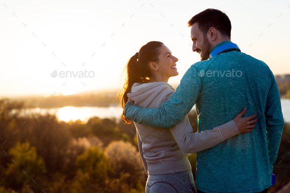 Portrait of man and woman during break of jogging - Stock Photo - Images