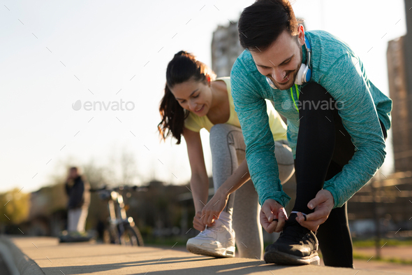Attractive man and beautiful woman jogging together - Stock Photo - Images