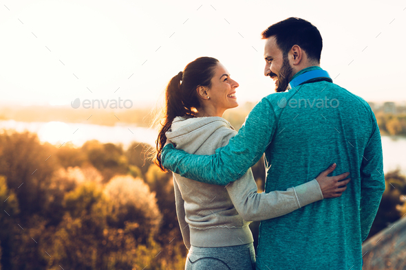 Happy young sporty couple sharing romantic moments - Stock Photo - Images