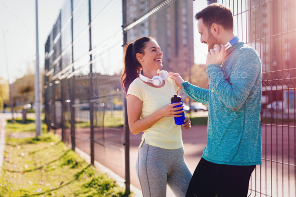 Handsome man and attractive woman talking on court - Stock Photo - Images