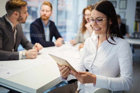 Business people working together on project and brainstorming in office - Stock Photo - Images
