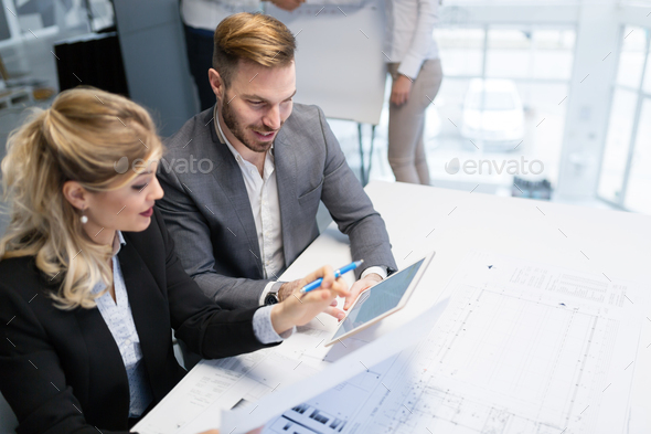 Team of architects working together on project - Stock Photo - Images
