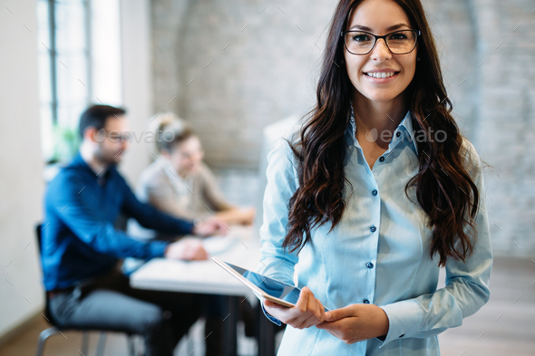 Young attractive architect working in modern office - Stock Photo - Images