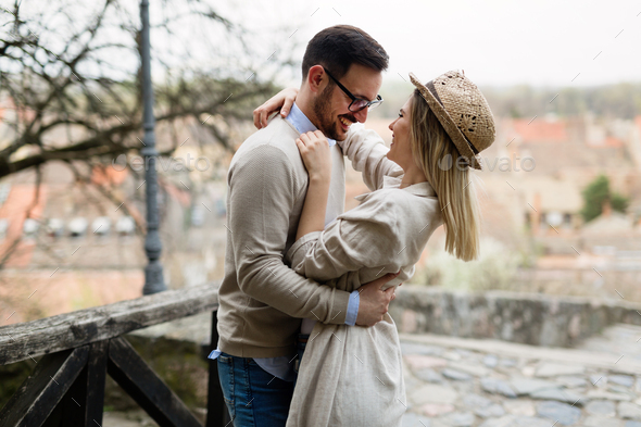Happy young couple in love hugging and smiling outdoor - Stock Photo - Images