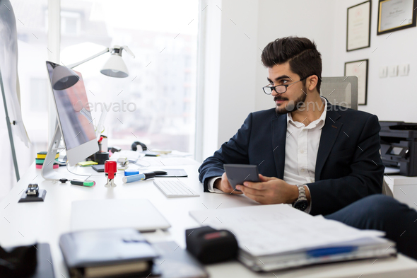 Young handsome architect working in his office - Stock Photo - Images
