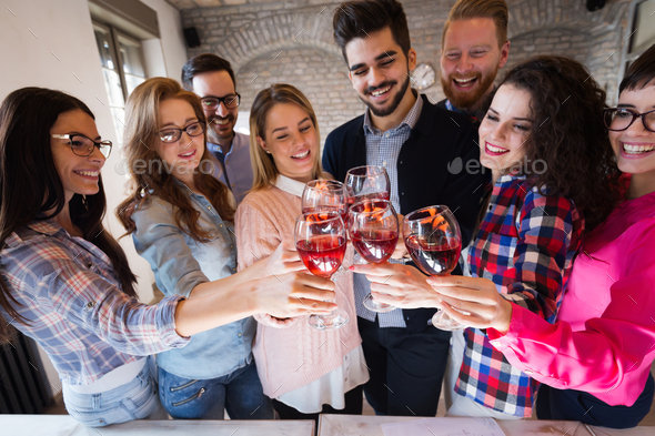 Office colleagues celebrating achievement of company goals - Stock Photo - Images