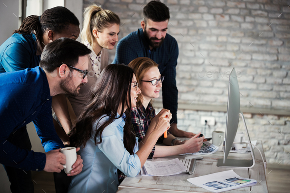 Young architects working on project in office - Stock Photo - Images