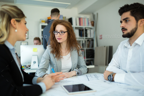Business colleagues collaborating and discussing project plans - Stock Photo - Images