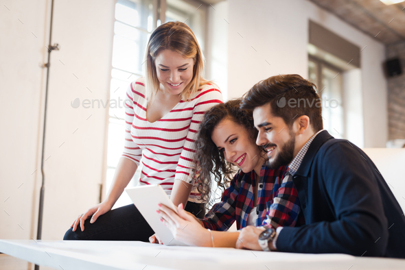 Picture of young architects discussing in office - Stock Photo - Images