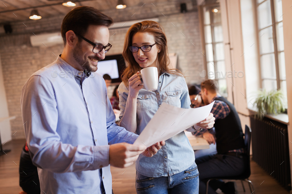 Young attractive architects discussing in modern office - Stock Photo - Images