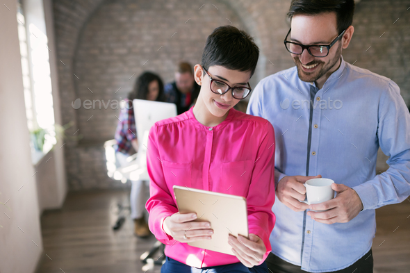 Business coworkers discussing new ideas and brainstorming in office - Stock Photo - Images
