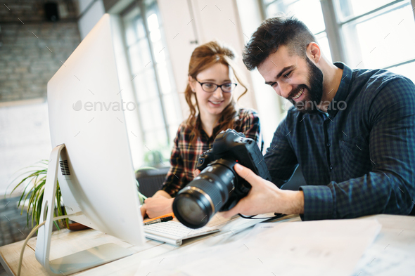Two young designers working in modern office - Stock Photo - Images