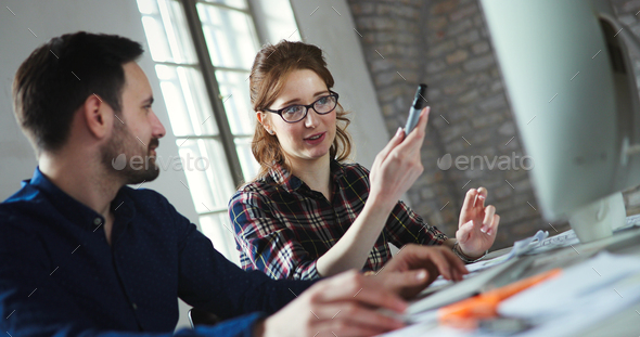 Portrait of young designers working on computer - Stock Photo - Images