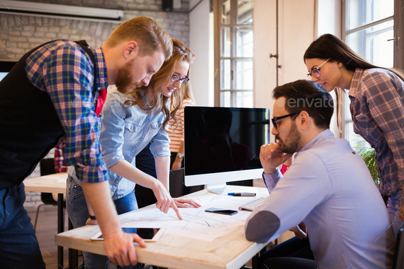 Coworkers working on project together in office - Stock Photo - Images