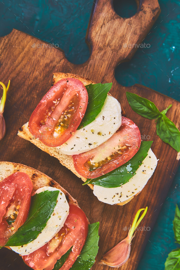 Bruschetta with tomatoes, mozzarella cheese and basil - Stock Photo - Images