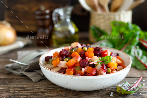 Beetroot or beet salad with boiled vegetables on wooden rustic table closeup - Stock Photo - Images