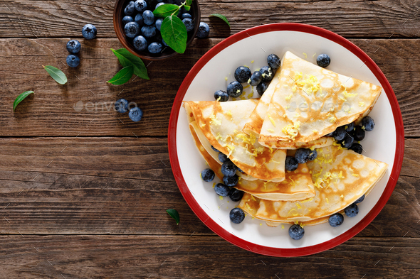 Sweet crepes filled with fresh blueberry - Stock Photo - Images