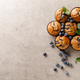 Blueberry muffins with fresh berries, top view - PhotoDune Item for Sale