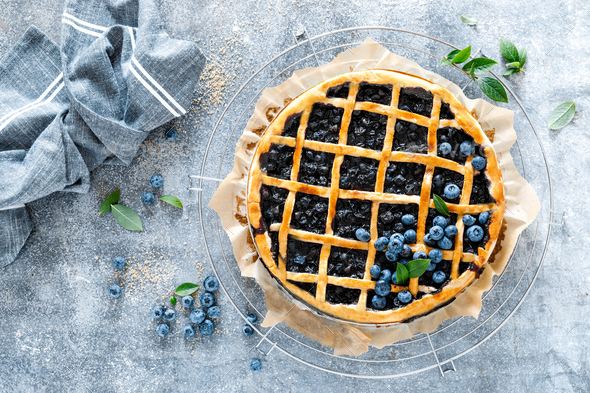 Traditional homemade american blueberry pie with lattice pastry, top view - Stock Photo - Images