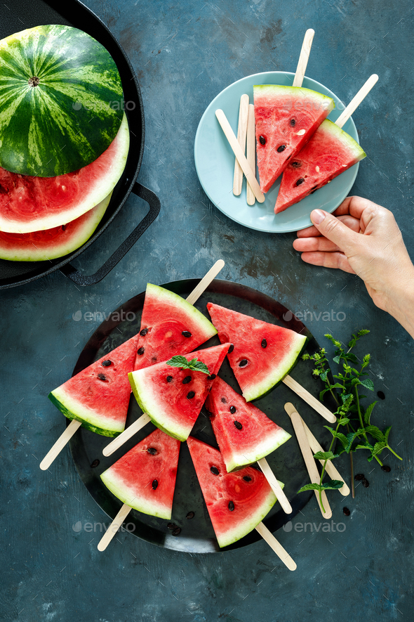 Watermelon slice popsicles on a blue background, top view - Stock Photo - Images