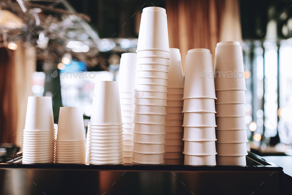 Lovely coffee glasses are standing on the top of the coffee machine in a cozy coffee shop - Stock Photo - Images