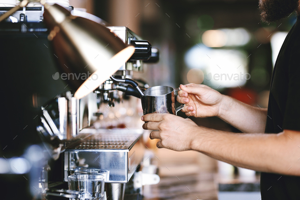 A modern expensive coffee machine is shown in work in modern cozy coffee shop - Stock Photo - Images