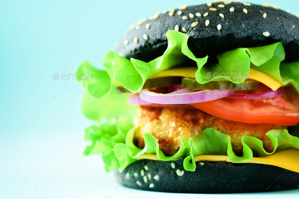 Delicious burger with beef, cheese, lettuce, onion, tomatoes on yellow background. Close up banner - Stock Photo - Images