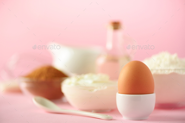 White cooking utensils on pink background. Food ingredients. Macro of egg. Cooking cakes and baking - Stock Photo - Images