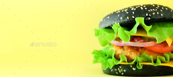 Fast food concept. Square crop. Juicy homemade hamburgers on yellow background. Take away meal - Stock Photo - Images