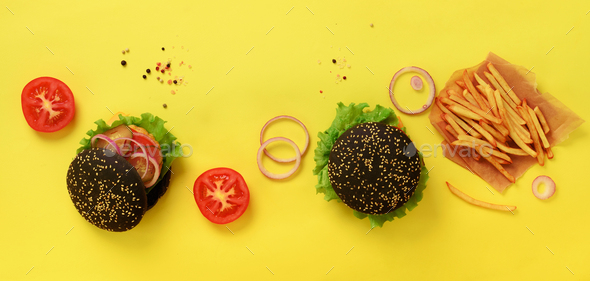Fast food banner. Juicy meat burgers with beef, tomato, cheese, onion, cucumber and lettuce on - Stock Photo - Images