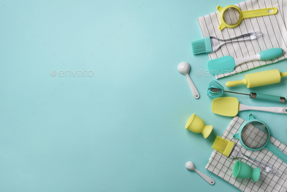 Pastel yellow, blue cooking utensils on turquoise background. Food ingredients. Cooking cakes and - Stock Photo - Images