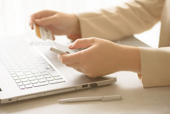 Hands holding credit card and smatrphone. Onine shopping. Business, remote work, always connect - Stock Photo - Images