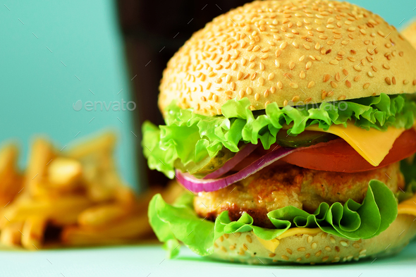 Homemade cheese burger or hamburger served with french fries on blue background. Copy space. Fast - Stock Photo - Images