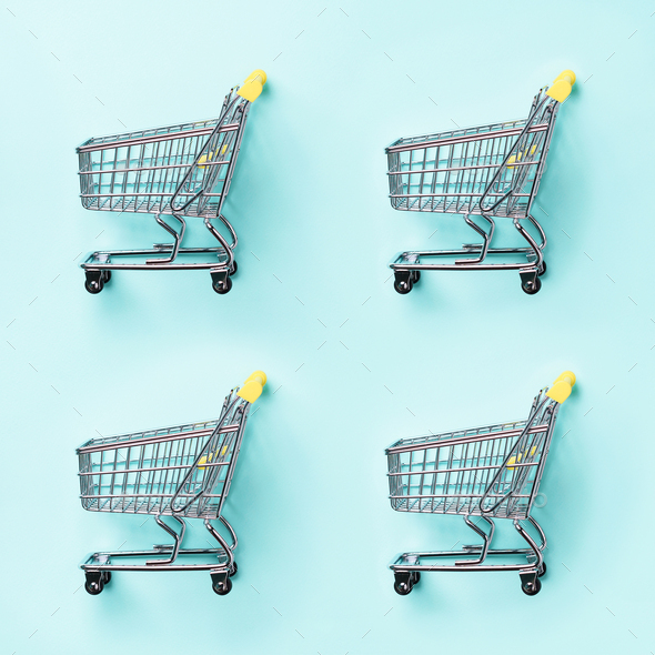 Shopping cart on blue background. Minimalism style. Creative design. Top view with copy space. Shop - Stock Photo - Images