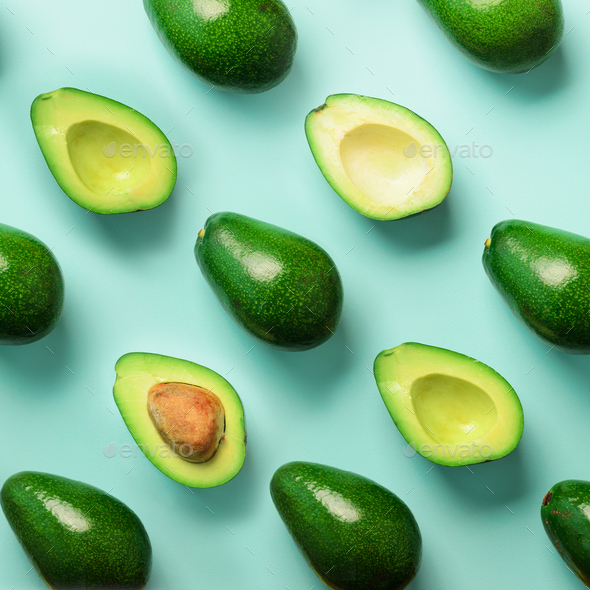 Avocado pattern on blue background. Top view. Banner. Pop art design, creative summer food concept - Stock Photo - Images