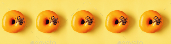 Flat lay donuts pattern on pastel orange background. Top view. Square crop. Sweet doughnut texture - Stock Photo - Images