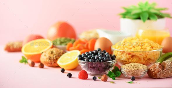 Vegetarian breakfast. Soft boiled egg, oat flakes, nuts, fruits, berries, milk, yogurt, orange - Stock Photo - Images