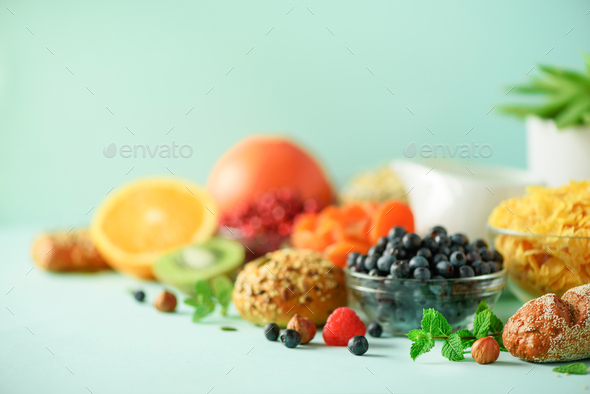 Vegetarian breakfast. Soft boiled egg, oat flakes, nuts, fruits, berries, milk, yogurt, orange - Stock Photo - Images