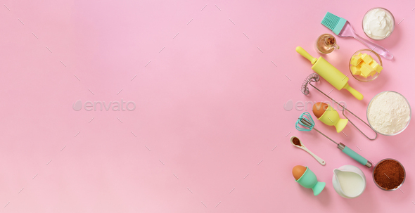 Banner of baking ingredients - butter, sugar, flour, eggs, oil, spoon, rolling pin, brush, whisk - Stock Photo - Images