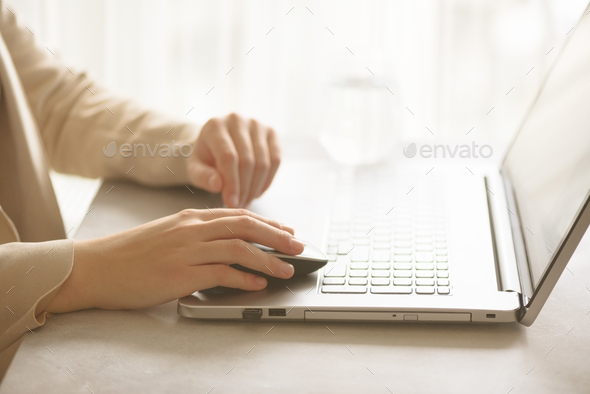 Woman working on computer close up. Woman hands typing on keyboard of laptop, online shopping detail - Stock Photo - Images