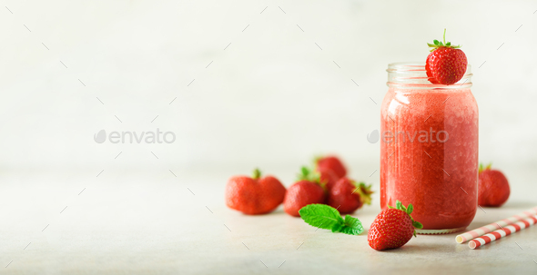 Bottle with vegan strawberry smoothie on grey background with copy space. Banner. Summer food - Stock Photo - Images