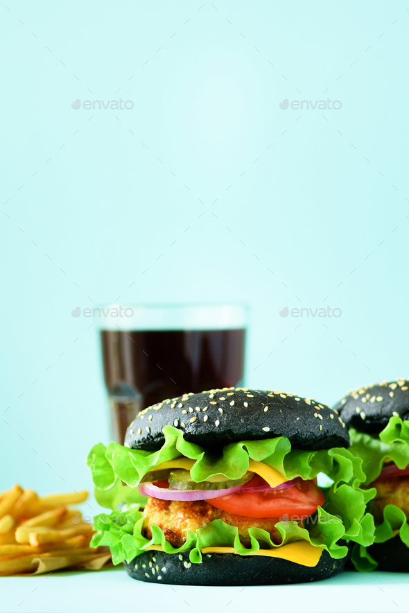 Fast food frame. Delicious meat burgers on blue background. Take away meal. Unhealthy diet concept - Stock Photo - Images