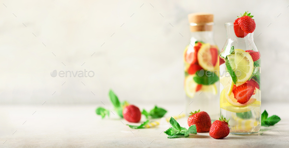 Detox water with mint, lemon on grey background. Citrus lemonade. Banner. Summer fruit infused water - Stock Photo - Images