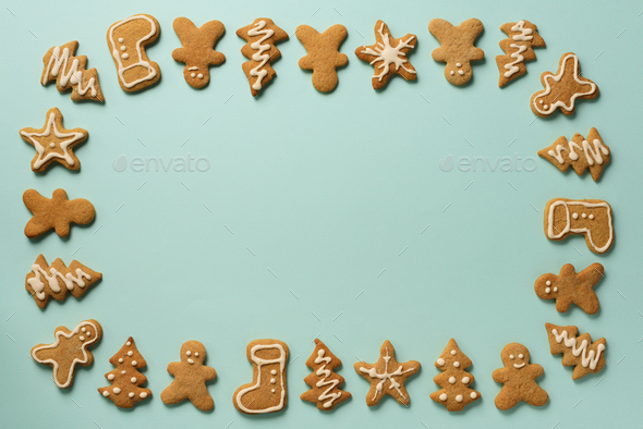 Frame of Christmas gingerbread cookies on blue background with copy space. Pattern of gingerbread - Stock Photo - Images