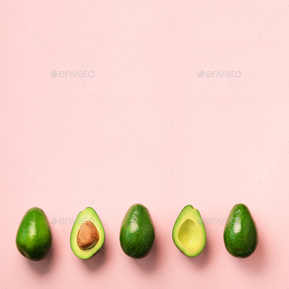Organic avocado with seed, avocado halves and whole fruits on pink background. Top view. Square crop - Stock Photo - Images