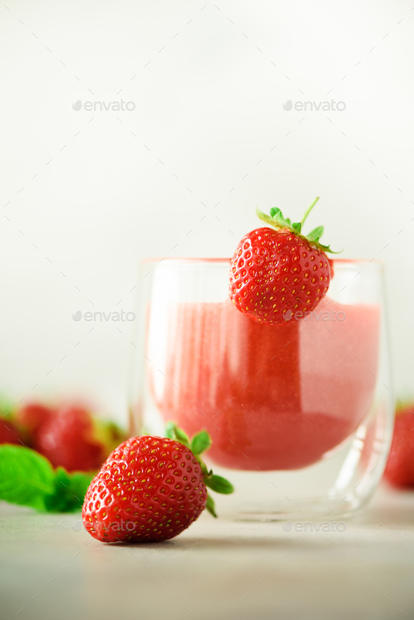 Healthy strawberry smoothie in glass on gray background with copy space. Banner. Summer food and - Stock Photo - Images