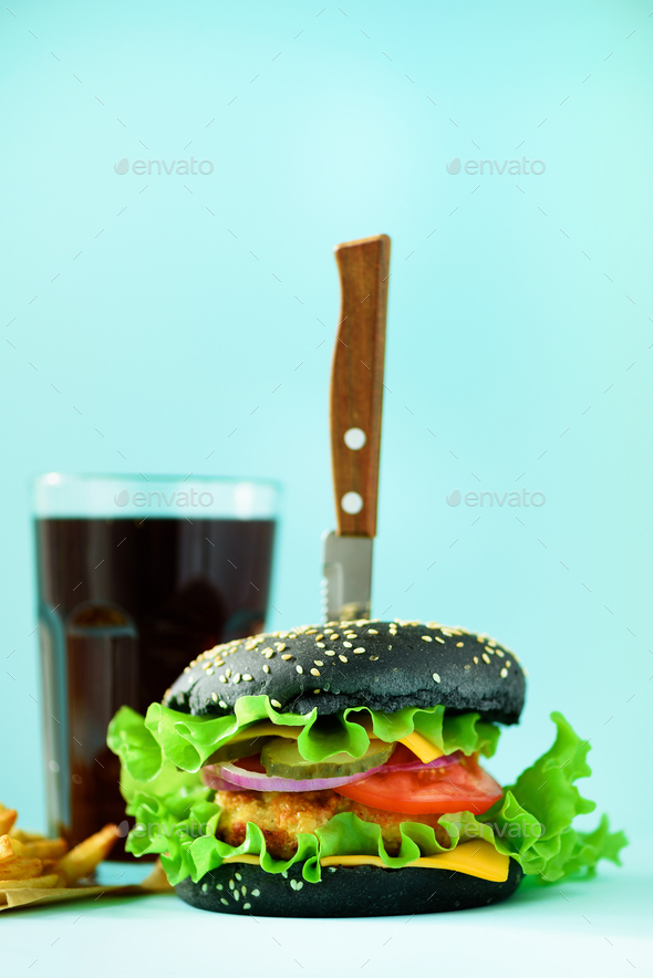 Fast food banner. Juicy meat burgers with cheese, lettuce on blue background. Take away meal - Stock Photo - Images